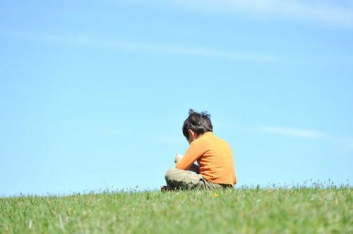 boy-sitting-alone